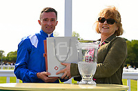 Jockey Dane O'Neill receives his prize from sponsors after winning Winner of The Smith & Williamson Fillies' Novice Stakes (Class 5)) during Afternoon Racing at Salisbury Racecourse on 17th May 2018
