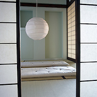 This Japanese-style room with traditional sliding shoji screens provides an enclosure for sleeping, meditating or relaxing
