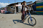 A boy on his bicycle in the street in Suto Orizari, Macedonia. The mostly Roma community, located just outside Skopje, is Europe's largest Roma settlement. .