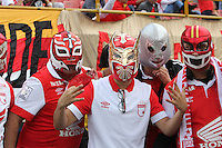 BOGOTA - COLOMBIA - 21-12-2014: Hinchas de Independiente Santa Fe, animan a su equipo durante partido de vuelta entre Independiente Santa Fe y Deportivo Independiente Medellin por la final de la Liga Postobon II-2014, en el estadio Nemesio Camacho El Campin de la ciudad de Bogota.  / Fans of Independiente Santa cheer for their team during a match of the second leg between Independiente Santa Fe and Deportivo Independiente Medellin for the finals of the Liga Postobon II -2014 at the Nemesio Camacho El Campin Stadium in Bogota city, Photo: VizzorImage / Nestor Silva / Cont.