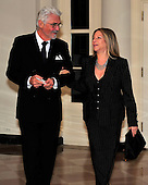 Barbra Streisand, right, and James Brolin, left, arrive for the State Dinner in honor of President Hu Jintao of China at the White House In Washington, D.C. on Wednesday, January 19, 2011. .Credit: Ron Sachs / CNP.(RESTRICTION: NO New York or New Jersey Newspapers or newspapers within a 75 mile radius of New York City)