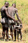 Surma tribesmen and child, Ethiopia