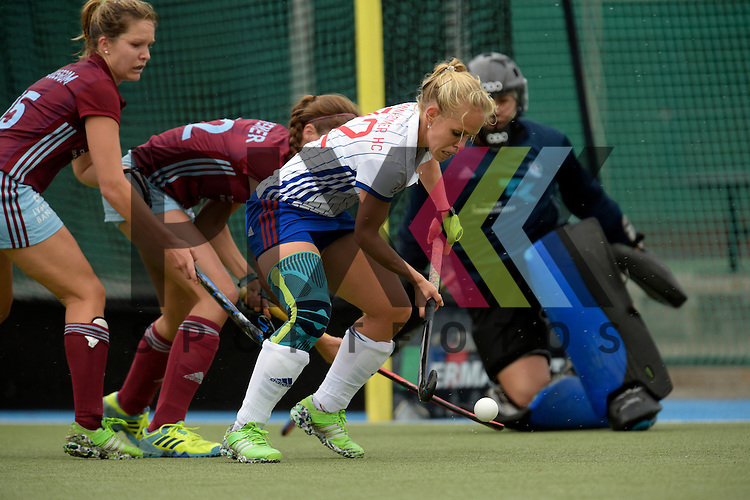 GER - Mannheim, Germany, September 18: During the women hockey match between Mannheimer HC (white) and UHC Hamburg (purple) on September 18, 2016 at Mannheimer HC in Mannheim, Germany. Final score 3-2 (HT 2-1).  Charlotte van Bodegom #15 of Uhlenhorster HC Hamburg, Jenny Siemer #22 of Uhlenhorster HC Hamburg, Lydia Haase #12 of Mannheimer HC<br /> <br /> Foto &copy; PIX-Sportfotos *** Foto ist honorarpflichtig! *** Auf Anfrage in hoeherer Qualitaet/Aufloesung. Belegexemplar erbeten. Veroeffentlichung ausschliesslich fuer journalistisch-publizistische Zwecke. For editorial use only.