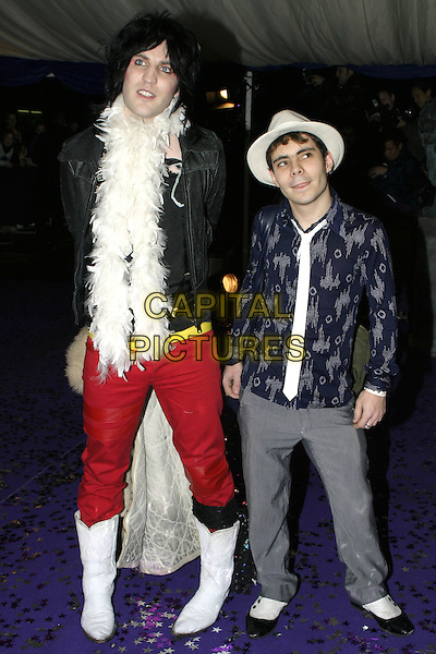 """THE MIGHTY BOOSH"".British Comedy Awards 2004, London Television Studios, London, December 22nd 2004..full length hat white feather boa cowboy boots red trousers.Ref: AH.www.capitalpictures.com.sales@capitalpictures.com.©Capital Pictures."
