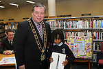 1st Class Student from St.Patricks NS, Ronan Gumba Williams receives an Ipad donated by the Mayors Office/Drogheda Borough Council  from Mayor Paul Bell at the Drogheda Counts Presentation in Drogheda Library...(Photo credit should read Jenny Matthews/NEWSFILE)...