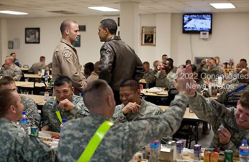 United States President Barack Obama greets U.S. troops at a mess hall at Bagram Air Field in Afghanistan, Sunday, March 28, 2010. .Mandatory Credit: Pete Souza - White House via CNP