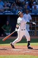 Yasmani Grandal #24 of the Miami Hurricanes follows through on his swing versus the Florida State Seminoles at Durham Bulls Athletic Park May 21, 2009 in Durham, North Carolina.  (Photo by Brian Westerholt / Four Seam Images)