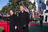 United States President Barack Obama, right, and President Francois Hollande of France walk to review the troops during an arrival ceremony on the South Lawn of the White House in Washington, D.C., U.S., on Tuesday, Feb. 11, 2014. <br /> Credit: Andrew Harrer / Pool via CNP