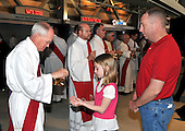 Washington, DC - April 17, 2008 -- An unidentified youg girl accepts communion from a priest as Pope Benedict XVI celebrates Mass at the new Nationals Park in Washington, D.C. on Thursday, April 17, 2008. This is the first non-baseball event in the park, which opened March 31..Credit: Ron Sachs / CNP.(RESTRICTION: NO New York or New Jersey Newspapers or newspapers within a 75 mile radius of New York City)