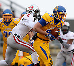 BROOKINGS, SD - NOVEMBER 22:  Dallas Goedert #86 from South Dakota State University hauls in a pass in front of Tyson Graham, Jr. #8 from the University of South Dakota in the first half of their game Saturday at Coughlin Alumni Stadium in Brookings. (Photo by Dave Eggen/Inertia)