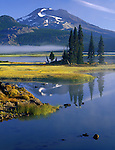 Deschutes National Forest, OR<br /> Summit of South Sister mountain (10,358) rises above clearing morning fog on Sparks Lake