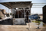 BAGHDAD, Iraq: 12th June 2014<br /> <br /> In Ghazaliyeh, a mixed Shiite-Sunni neighborhood in Baghdad where renewed sectarian tensions are rising, a strip of Sunni-owned stores was vandalized shortly after the fall of Mosul. The storefronts were smashed and unidentified assailants killed one vendor. In the next block on the same street, a general store is still open, unmolested. &ldquo;It&rsquo;s Shiite,&rdquo; a resident said by way of explanation.<br /> <br />  <br /> <br /> <br /> Fixer: Haider Kata +9647704425647<br /> <br /> Ayman Oghanna for National Geographic