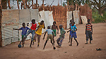 Children play football in Bunj, the host community for the Doro Refugee Camp in Maban County, South Sudan. Doro is one of four camps in Maban that together shelter more than 130,000 refugees from the Blue Nile region of Sudan. Jesuit Refugee Service provides educational and psycho-social services to both refugees and the host community.<br /> Misean Cara supports the work of JRS in the Maban camps and host community.
