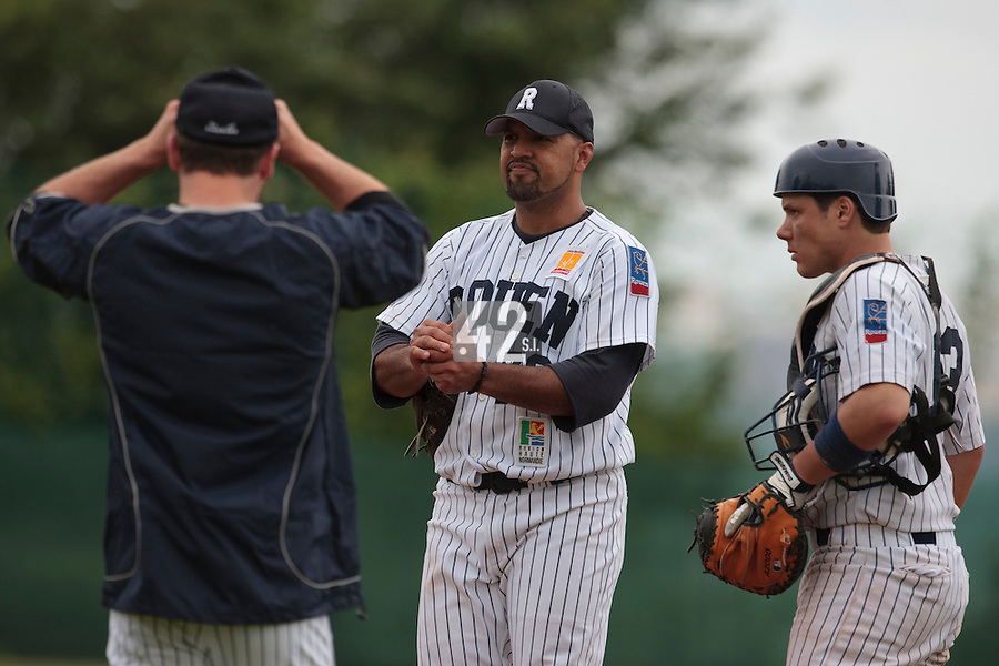 03 June 2010: Starting pitcher Keino Perez of Rouen listens to Mike Musgrave next to Boris Marche during the 2010 Baseball European Cup match won  8-4 by C.B. Sant Boi over the Rouen Huskies, at the Kravi Hora ballpark, in Brno, Czech Republic.