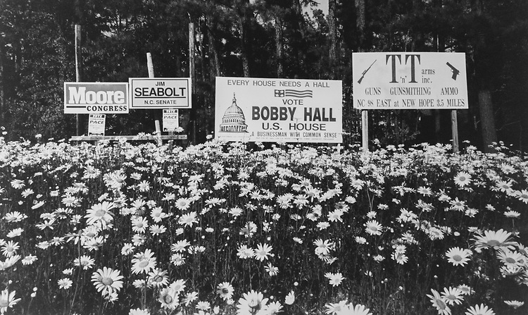 Campaign signs on highway 401, North of Raleigh, North Carolina in field of daisies on April 28, 1994. (Photo by Laura Patterson/CQ Roll Call via Getty Images)