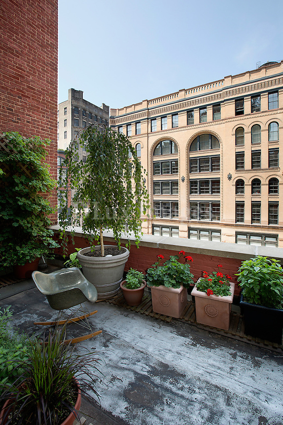 flowerpots in the balcony<br /> <br /> The loft residence of artist Andrew Spence and his wife, Sique, on Varick Street in the Tribeca area of New York City.