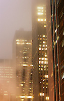 AVAILABLE FROM JEFF AS A FINE ART PRINT.<br /> <br /> AVAILABLE FOR LICENSING FROM GETTY IMAGES.  Please go to www.gettyimages.com and search for image # a0142-000206.<br /> <br /> Office Buildings in Midtown Manhattan on a Misty, Overcast Night, New York City, New York State, USA