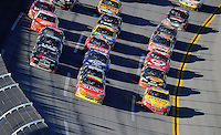 Nov. 1, 2009; Talladega, AL, USA; NASCAR Sprint Cup Series drivers David Stremme (12) leads the outside row, Jeff Gordon (24) leads the middle row and Kevin Harvick (29) leads the inside line during the Amp Energy 500 at the Talladega Superspeedway. Mandatory Credit: Mark J. Rebilas-