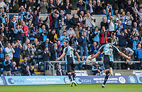 Michael Harriman of Wycombe turns to celebrate with the supporters after scoring his second goal during the Sky Bet League 2 match between Wycombe Wanderers and Hartlepool United at Adams Park, High Wycombe, England on 5 September 2015. Photo by Andy Rowland.