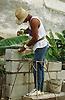 Builder cementing breeze block wall at Gibara; Cuba,