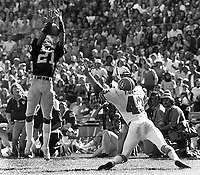 Oakland Raiders Cliff Branch grabs pass against the Denver Bronco's...#43 Fuller..(1977 photo/Ron Riesterer)