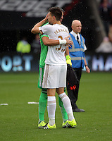 Pictured L-R: Goalkeeper Sergio Romero of Manchester United hugs Federico Fernandez of Swansea at the end of the game Sunday 30 August 2015<br /> Re: Premier League, Swansea v Manchester United at the Liberty Stadium, Swansea, UK