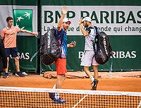 Paris, France, 30 May, 2019, Tennis, French Open, Roland Garros, Men's doubles seccond round:  Matwe Middelkoop (NED) (L) and Tim Puetz GER) leaving the court and waiving to the crowd after loosinf the match<br /> Photo: Henk Koster/tennisimages.com