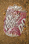 Crushed Dr Pepper can in the street, Spur, Tex.