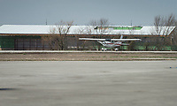 NWA Democrat-Gazette/BEN GOFF @NWABENGOFF<br /> An airplane lands, with the new flight center under construction in the background, Friday, March, 23, 2018, at Bentonville Municipal Airport.