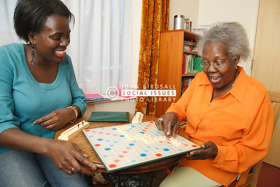 Daughter and mother playing scrabble.