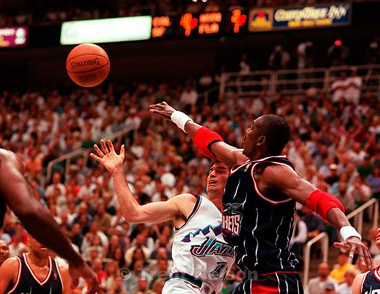 John Stockton and Hakeem Olajuwon collide at game two, Western Conference Finals, NBA Playoffs, Utah Jazz defeated Houston Rockets.<br />