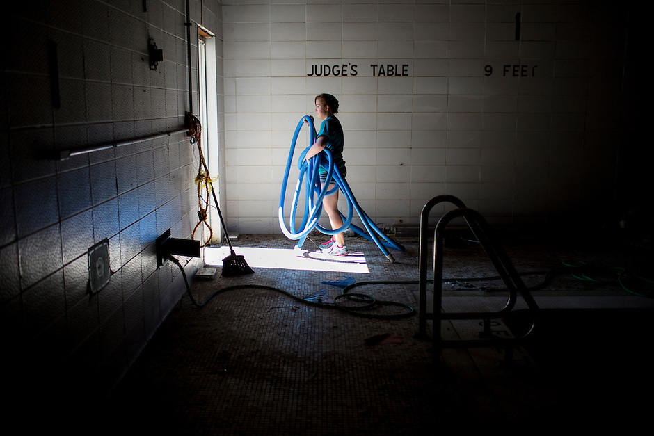 "A member removes hoses from a pool area during ""Circle the City with Service,"" the Kiwanis Circle K International's 2015 Large Scale Service Project, on Wednesday, June 24, 2015, at the Friendship Westside Center for Excellence in Indianapolis. (Photo by James Brosher)"