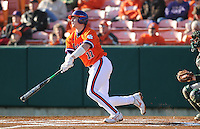 Catcher John Nester (17) hits in a game between the Charlotte 49ers and Clemson Tigers Feb. 20, 2009, at Doug Kingsmore Stadium in Clemson, S.C. (Photo by: Tom Priddy/Four Seam Images)
