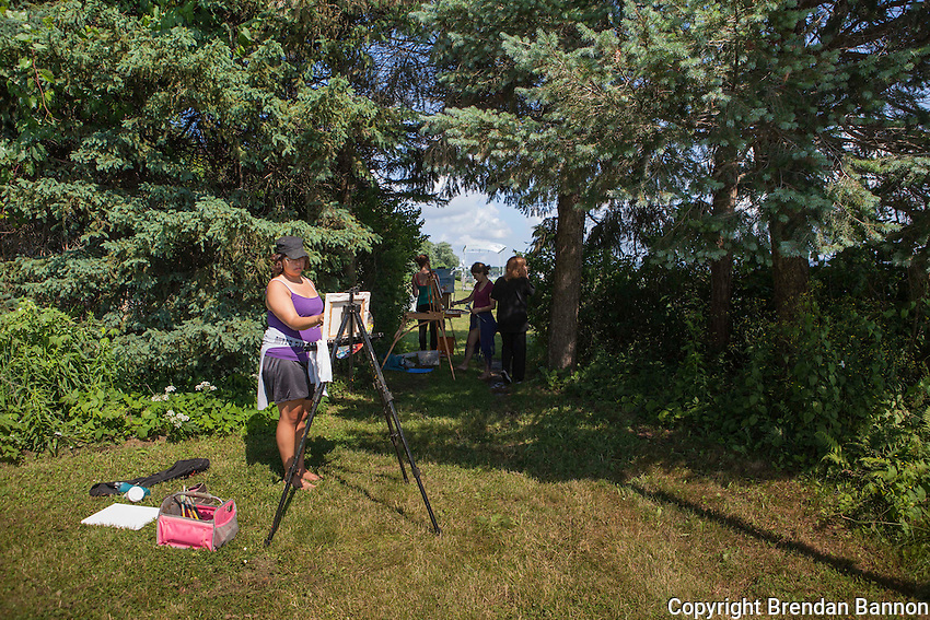 Chautauqua School of Art students in Margaret Grimes' landscape class paint at the water's edge on Lake Chautauqua. The Institution runs a series of schools that span the summer season, art, dance and music are among them. Chautauqua, NY. June 27, 2014. Photo by Brendan Bannon