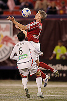 New York Red Bulls forward (9) John Wolyniec chests the ball in front of New England Revolution defender (6) Jay Heaps. The Revolution defeated the Red Bulls 2-0 in an MLS regular season match at Giants Stadium, East Rutherford, NJ, September 20, 2006.