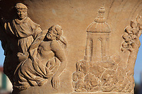 Detail of a relief depicting a monk with a dead or dying man shrouded in cloth and a Greek pagoda on a rocky mountain, on a stone pillar from a religious statue on the Charles Bridge or Karluv most, built 1357 - 15th century across the Vltava river, Prague, Czech Republic. The historic centre of Prague was declared a UNESCO World Heritage Site in 1992. Picture by Manuel Cohen