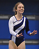 Meghan Maquet of Long Beach smiles after concluding her floor routine in a varsity gymnastics meet against Bethpage at Long Beach High School on Monday, Jan. 4, 2016. She scored an 8.85 in the event and posted the top all-around score of 32.55. Long Beach won the meet by a score of 151.55-147.60.