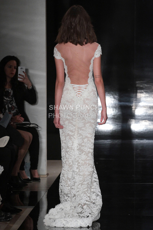 Model walks runway in an off-shoulder re-embroidered Chantilly lace gown with laced up back, from the Reem Acra Spring 2017 bridal collection, during New York Bridal Fashion Week Spring Summer 2017, on April 15, 2016.