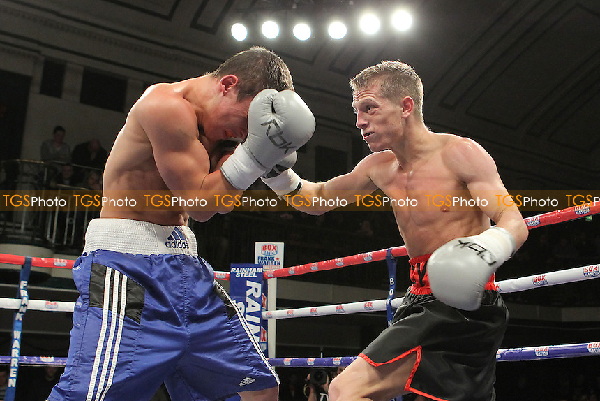Charlie Hoy (black/red shorts) defeats Francis Croes in a Super-Flyweight boxing contest at York Hall, Bethnal Green, London, promoted by Frank Warren - 01/11/12 - MANDATORY CREDIT: Gavin Ellis/TGSPHOTO - Self billing applies where appropriate - 0845 094 6026 - contact@tgsphoto.co.uk - NO UNPAID USE.