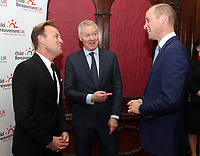 Prince William, Duke of Cambridge speaks with Rory Bremner and Jason Donovan during the Child Bereavement 25th birthday gala dinner at Kensington Palace in London. HRH is a patron of Child Bereavement UK. The charity works to help families to rebuild their lives after the devastation of child bereavement. Photo Credit: ALPR/AdMedia