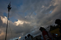 A boy climbs a pole in Jacmel's Pechinat camp for displaced persons. A large Venezulan flag later flew there. The 7.0 earthquake that devastated parts of Haiti on January 12 killed hundreds of thousands of people. January's earthquake killed hundreds of thousands of people and caused significant and lasting structural and economic damage in the Caribbean nation.