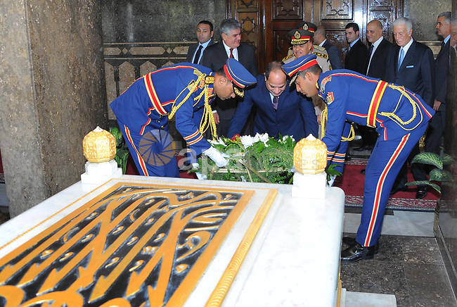 Egyptian President Abdul Fattah al-Sisi pays his respects in front of the grave of former Egyptian President Gamal Abdel Nasser during a ceremony at the memorial of the Unknown Soldier and tombs of late Egyptian presidents on October 4, 2017 in Cairo, as part of the celebrations marking the 42th anniversary of October War Victory. Photo by Egyptian President Office