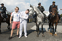 MEXICO CITY, MEXICO - June 11, 2017:  USA fans pose with Mexican police horses before the World Cup Qualifier match against Mexico at Azteca Stadium.