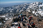 Top of Toubkal (4165 m).Climbing of the mountain Toubkal (4165 m) with mountaineering skis, highest summit of North Africa. Atlas range. Morocco. Africa