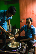 Workers use heat to prepare the Choorna Pinda Sueda (powder treatments) for Ayurvedic treatments at the Nagarjuna Ayurvedic Centre in Kochi, Kerala, India.