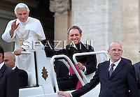 Pope Benedict XVI personal secretary Mons. Georg Gaenswein,  personal bodyguard Domenico Giani waves as he leaves his weekly general audience on June 2, 2010 at St Peter's square at The Vatican.