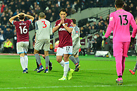 Mark Noble of West Ham United shoots over the bar during West Ham United vs Liverpool, Premier League Football at The London Stadium on 4th February 2019