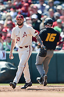 NWA Democrat-Gazette/CHARLIE KAIJO Arkansas Razorbacks Cody Scroggins (57) tags out University of Missouri Luke Mann (16) during a baseball game, Sunday, March 17, 2019 at Baum-Walker Stadium in Fayetteville.