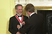 "The British Ambassador, Sir Christopher Meyer KCMG, confers Honorary Knighthood on film director Steven Spielberg at a ceremony at the British Embassy in Washington, DC on January 29, 2001.  In his remarks the Ambassador said ""The award of an Honorary Knighthood to Steven Allan Spielberg is in recognition of his unique and outstanding contribution to international film, and in particular his services to the entertainment industry of the United Kingdom"".  He concluded by saying "" Mr. Spielberg epitomises the cultural partnership between our two countries.  I am privileged to present this historic award tonight on behalf of Her Majesty the Queen""..Credit: Ron Sachs / Pool via CNP"