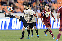 Houston, TX - Friday December 9, 2016: Jon Bakero (7) of the Wake Forest Demon Deacons gains control of a loose ball against the Denver Pioneers at the NCAA Men's Soccer Semifinals at BBVA Compass Stadium in Houston Texas.